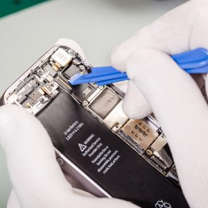 close up image of a team member repairing a smartphone